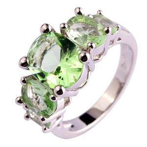 Jewelry - Gorgeous emerald green 5 stone 925 silver ring nwt